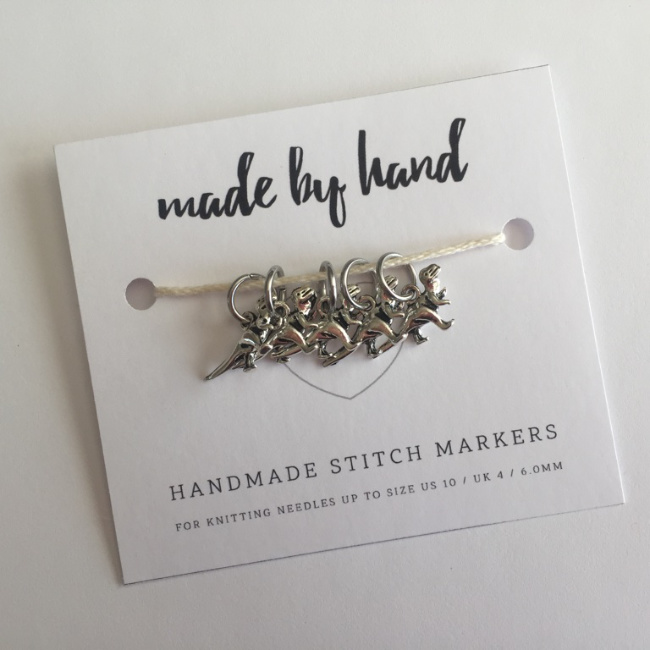Photo of t-rex stitch markers on Made by Hand packaging