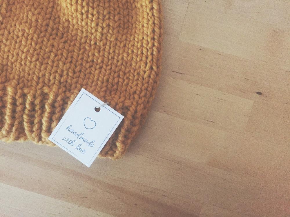 Handmade hang tag on a handmade hat