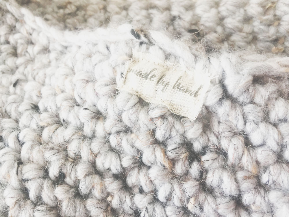 patch label attached to a crochet cowl